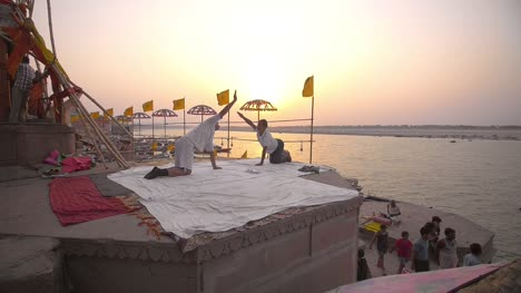 People-Doing-Yoga-In-front-of-River-Ganges
