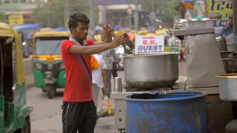 Street-Food-Vendor-Stirs-Large-Pot