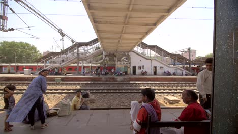 Indian-Man-Carries-Bags-Across-a-Train-Track