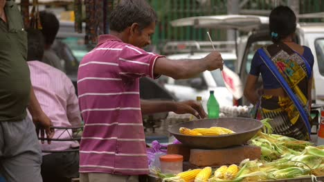 Indian-Street-Food-Vendor-Cooking-Sweetcorn