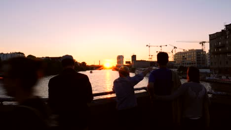 People-Overlooking-River-Spree-at-Sunset