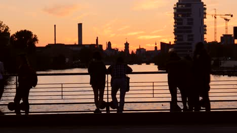 Silhouetted-Tourists-Overlooking-River-at-Sunset
