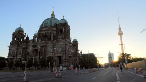 Cyclist-Passing-the-Berlin-Cathedral-at-Sunrise