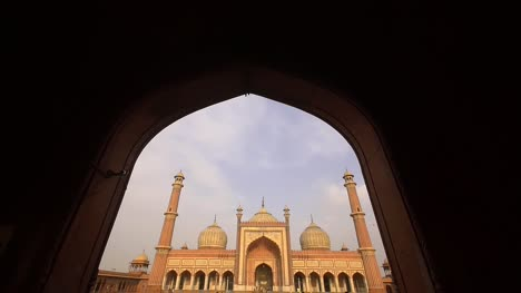 Reveal-Shot-of-Jama-Masjid-Though-an-Archway