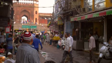 Man-Beckoning-on-Crowded-Indian-Street