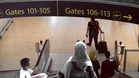 Mother-and-Son-Heading-To-Departure-Gate-at-Airport