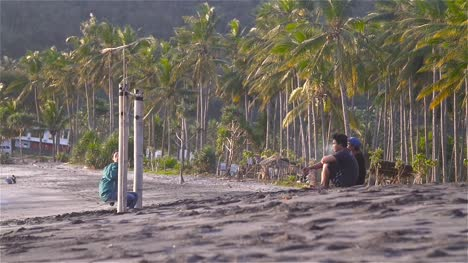 Group-of-People-Sat-on-Quiet-Beach