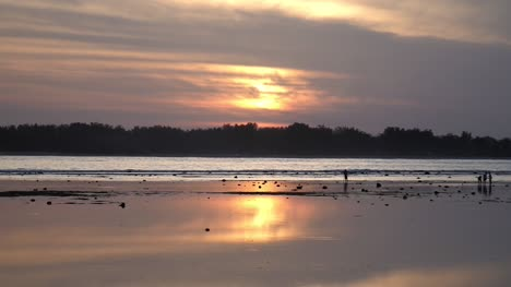 Sunset-Reflected-in-Wet-Sand