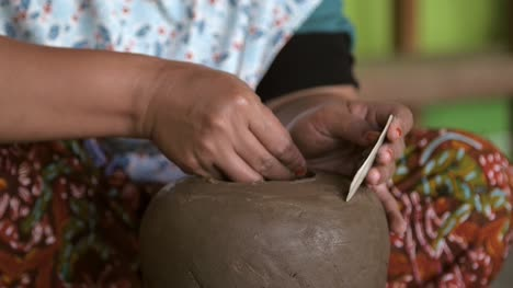 Woman-Smoothing-Clay-Pot
