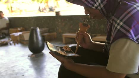 Indonesian-Woman-Decorating-a-Dish