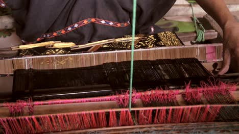 Woman-Removing-and-Inserting-Weaving-Sword