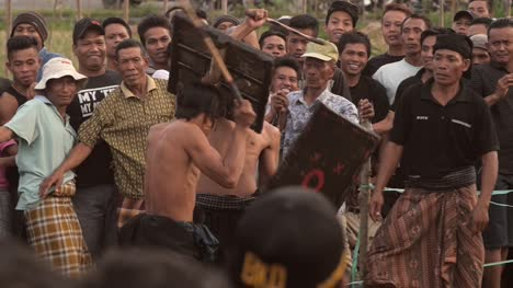 Indonesian-Men-Fighting-With-Sticks-and-Shields