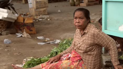 Elderly-Indonesian-Woman-Sitting-on-the-Ground