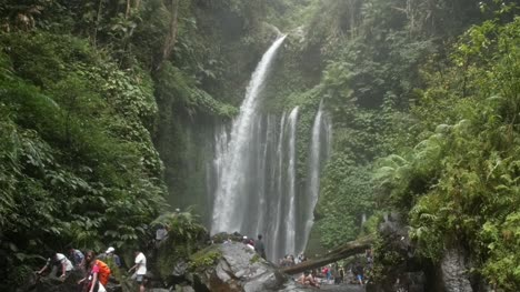 Sightseers-at-a-Waterfall-in-Indonesia