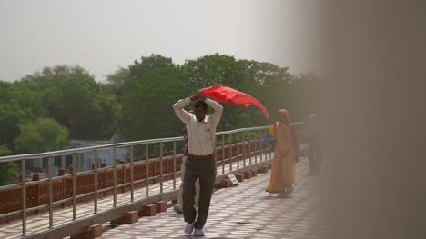 Indian-Man-Covering-Head-With-Red-Shawl