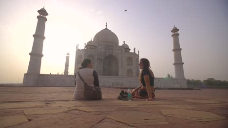 Two-Women-Sitting-by-the-Taj-Mahal
