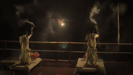 Two-Men-Performing-the-Ganga-Aarti-Ceremony