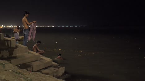 Men-and-Boy-Bathing-in-the-Ganges-at-Night