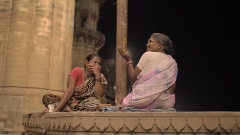 Two-Ladies-Sitting-and-Talking-at-Night