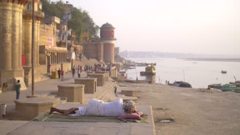 Elderly-Woman-Lying-on-a-Wall-by-the-Ganges