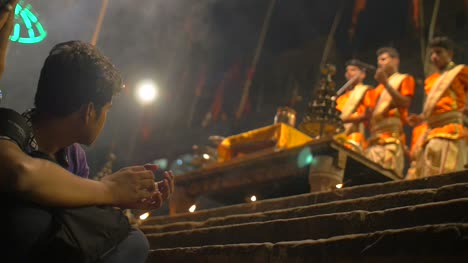 Man-Clapping-Along-to-Ganga-Aarti-Ceremony