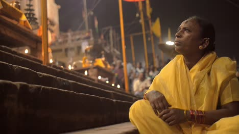 Elderly-Woman-Sitting-on-Ghats-at-Night
