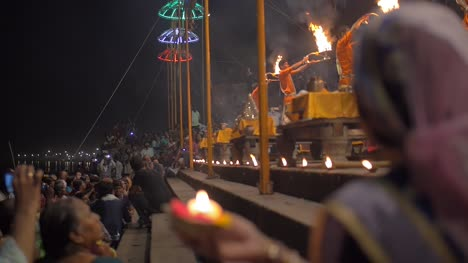 Woman-Holds-Candle-at-Ganga-Aarti-Ceremony