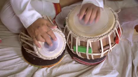 Handheld-Shot-of-Hands-Playing-Tabla