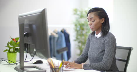 Young-Female-Professional-Working-at-Desk-3