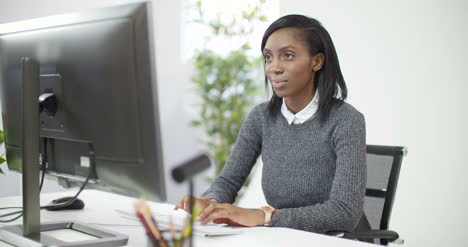 Young-Professional-Woman-Working-at-Computer