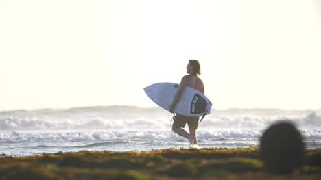 Surfer-Walking-into-the-Sea
