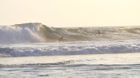 Slow-Motion-Shot-of-a-Man-Surfing