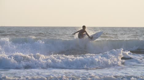 Tracking-Shot-of-a-Man-Surfing-in-the-Sea