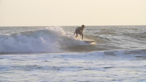 Tracking-Shot-of-a-Man-Surfing-a-Wave