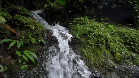 Tracking-Shot-of-a-Small-Waterfall
