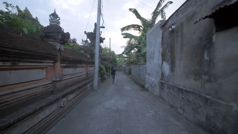 Man-Walking-Down-an-Indonesian-Street