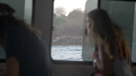 Woman-Looking-Out-Boat-Window