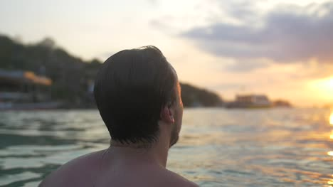 Swimmer-Looking-Out-Over-Ocean-at-Sunset