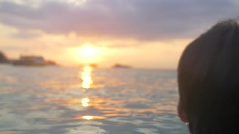 Man-Smiling-in-the-Sea-at-Sunset