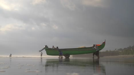 Men-Wheeling-a-Fishing-Canoe-into-the-Sea