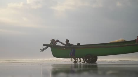Boy-Wheeling-a-Fishing-Canoe-into-the-Sea