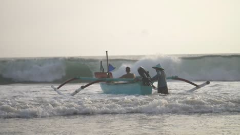 Pushing-a-Fishing-Canoe-Into-the-Waves