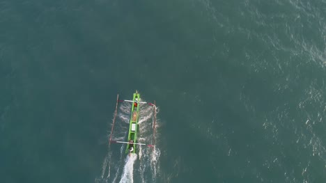 Aerial-View-of-an-Outrigger-on-the-Water