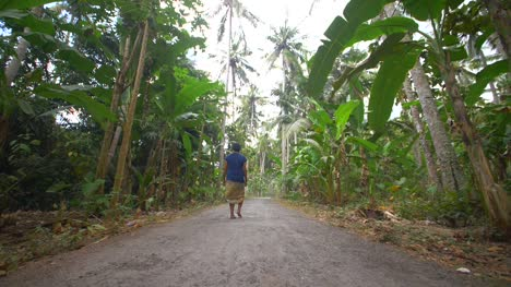 Woman-Walking-Down-a-Jungle-Road