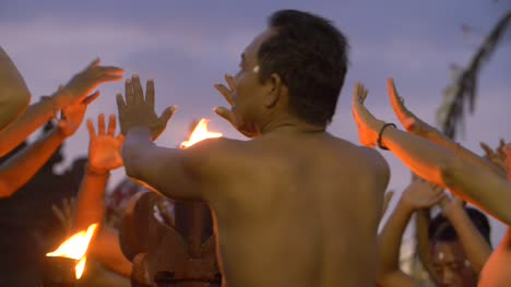 Men-Chanting-the-Kecak-by-a-Fire-at-Dusk