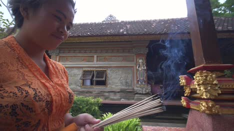 Woman-Burns-Incense-in-an-Indonesian-Temple