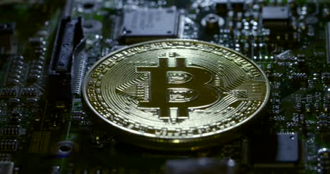 Reveal-Shot-of-a-Casascius-Bitcoin-on-a-Circuit-Board
