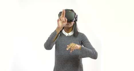 Young-Woman-Gesturing-with-VR-Headset