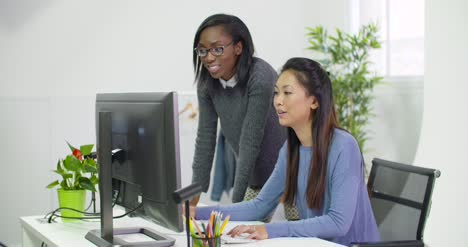 Two-Young-Business-Women-Working-at-Computer