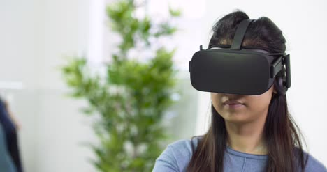 Young-Lady-Looking-Around-in-VR-Headset